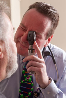 Doctor providing eye exam to Medicare patient