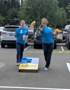 Denise Martel, CEO, playing SFM cornhole