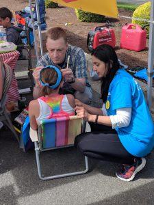 Dr. Aversa and Dr. Chawla face painting at SFM's wellness carnival
