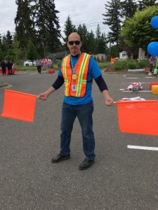 Joseph Crain, our Chief Operations Officer, helping families safely cross the street
