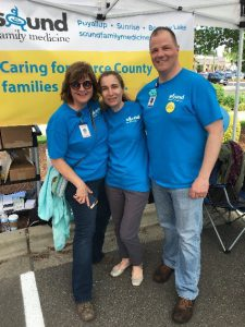 Darcie Baker, Dr. Vladimir and Dale Nelson at Sound Family Medicine's wellness carnival