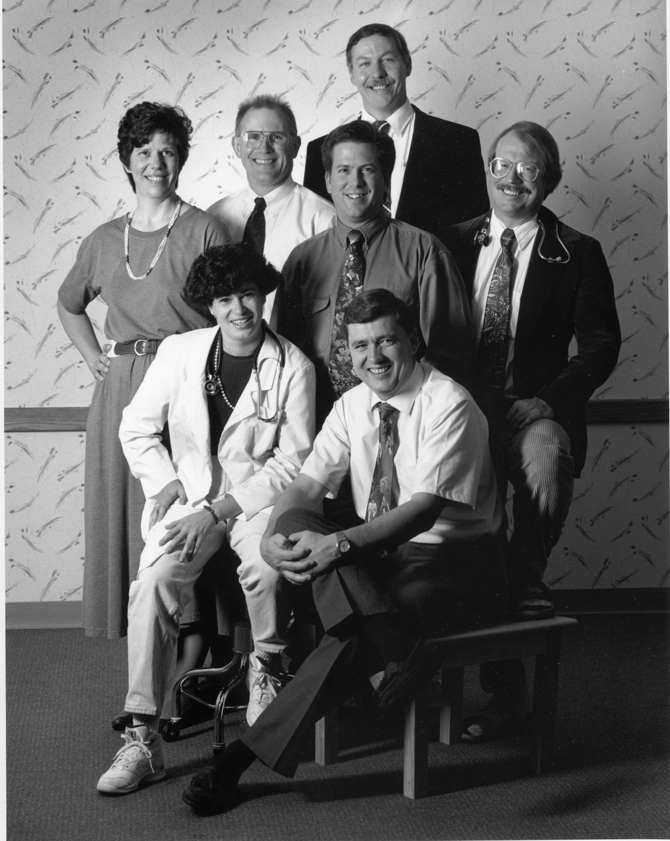 A black and white photo featuring providers from South Hill Family Medicine including Dr. Nancy Grubb (left), and Dr. Edward Pullen (to her right), Dr. Donald Sinden (front) and Curtis Allen, PA (right)