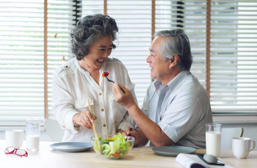 Senior couple eating vegetables