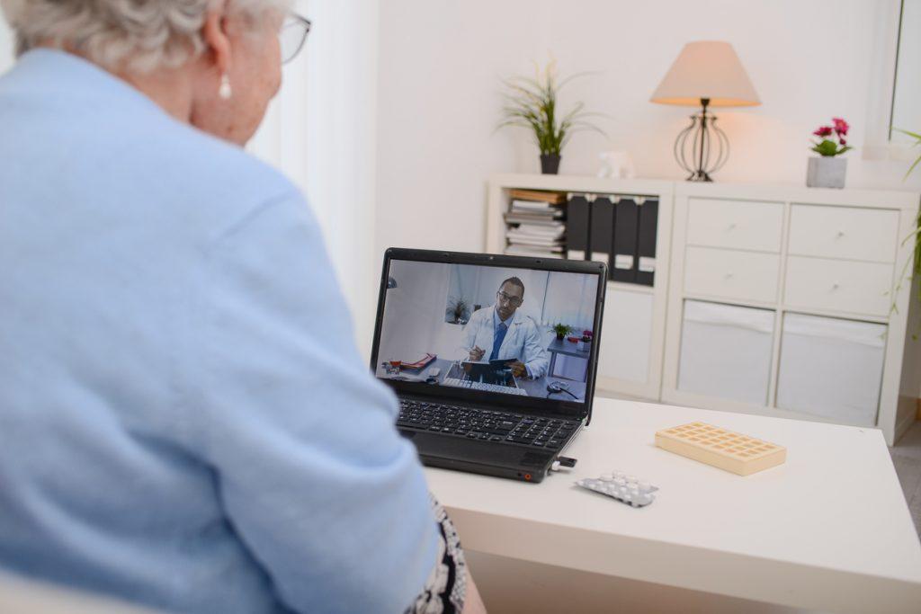 Senior seeing doctor via video visit