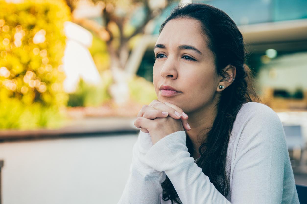 woman thinking wistfully